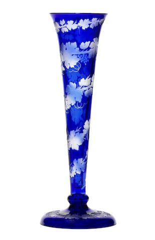 A tall Bohemian blue overlay trumpet shaped vase, mid 19th century