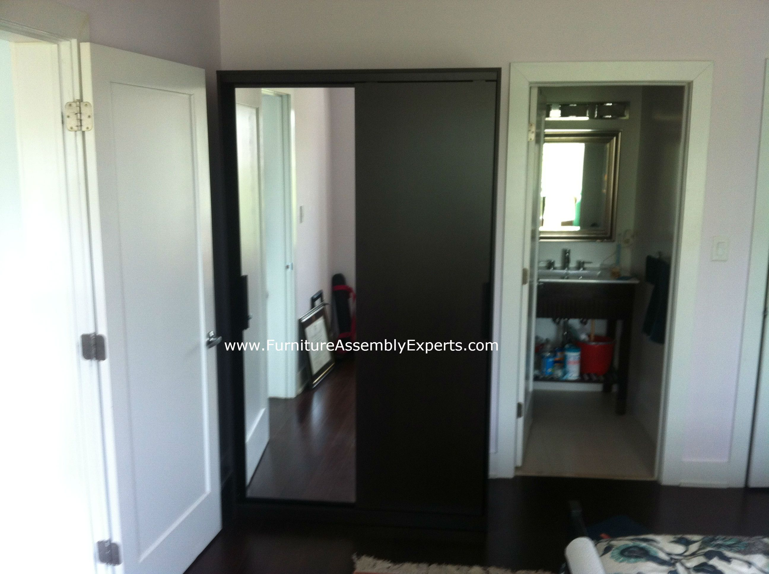Ikea morvik wardrobe with sliding doors assembled in for Ikea arlington va