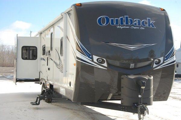 2013 Outback 298re Triple Slide Rear Entertainment Kitsmiller Rv