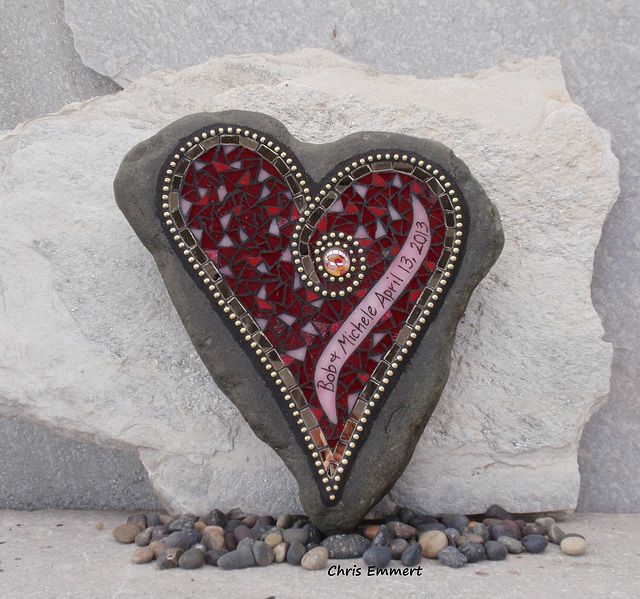 """Mosaic on Rock - Wedding Stone  A Wedding Gift. Commissioned.  Bronze Mirror glass, gold ball chain, red and pinks sheet glass on heart shaped Pennsylvania Blue Stone. Etched names and date. 11"""" x 12"""" x 2½"""" Website    Etsy    Facebook ____________"""