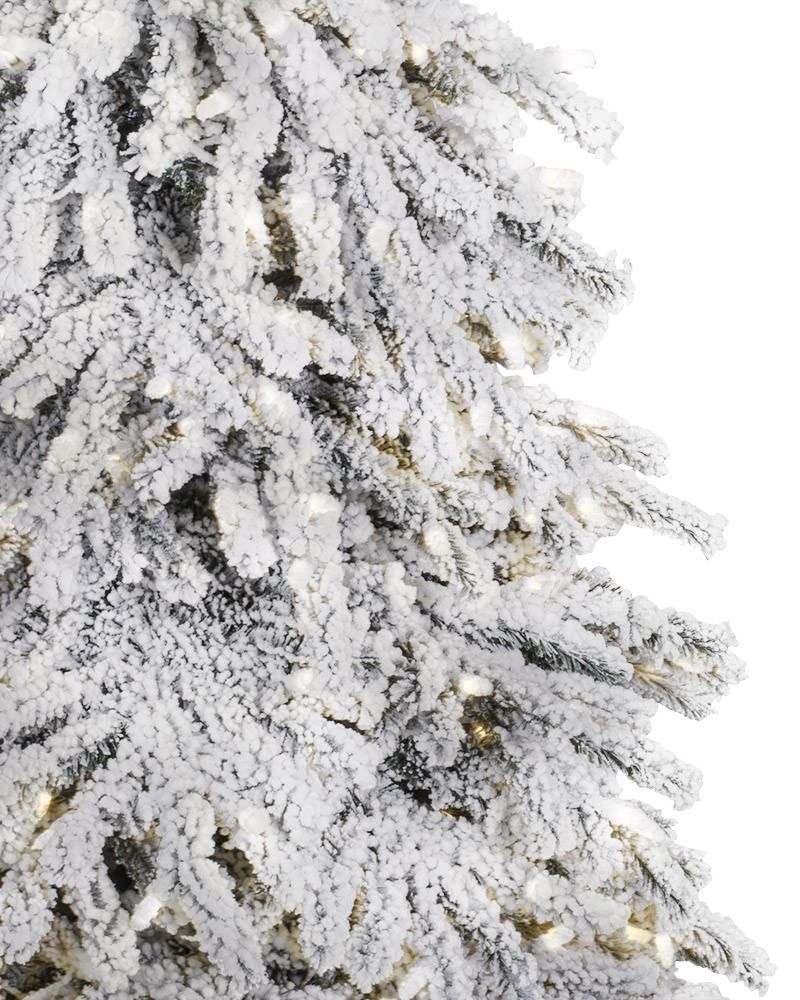 Have a merry white Christmas with a snow covered Christmas tree ...