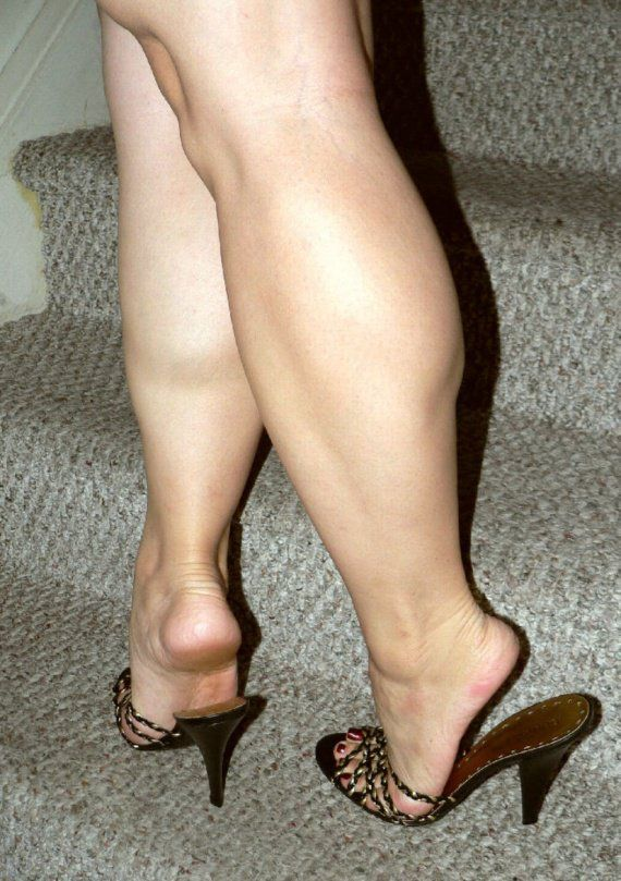 Black strappy mules and outstanding calves