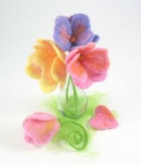 taking wet felted heart shapes and felting them together to create a pretty flower bouquet.