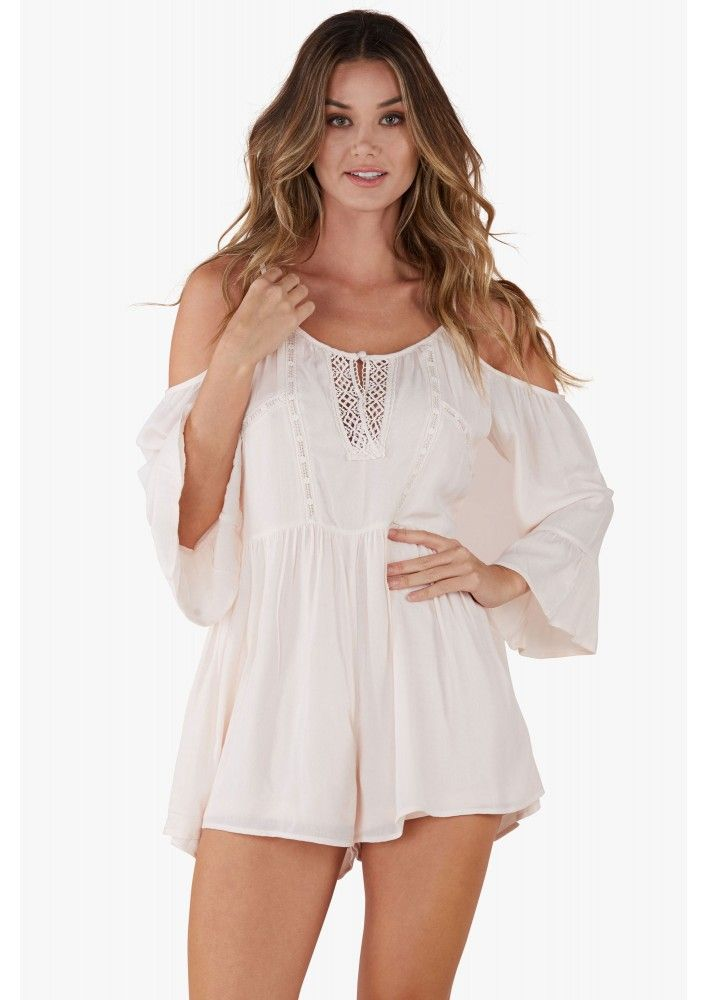 Channel vacation style with this peasant style romper. Cold shoulder design with flare sleeves an...