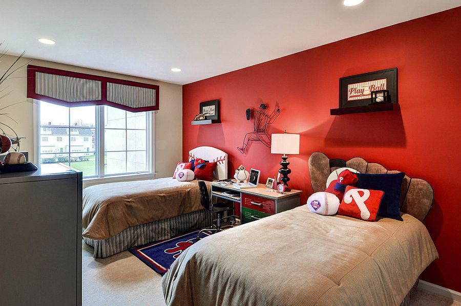 Baseball themed kids' bedroom with a striking red accent wall - Decoist