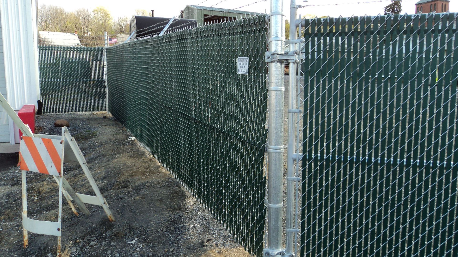 Galvanized Chain Link Fence With Green Privacy Slats Installed By