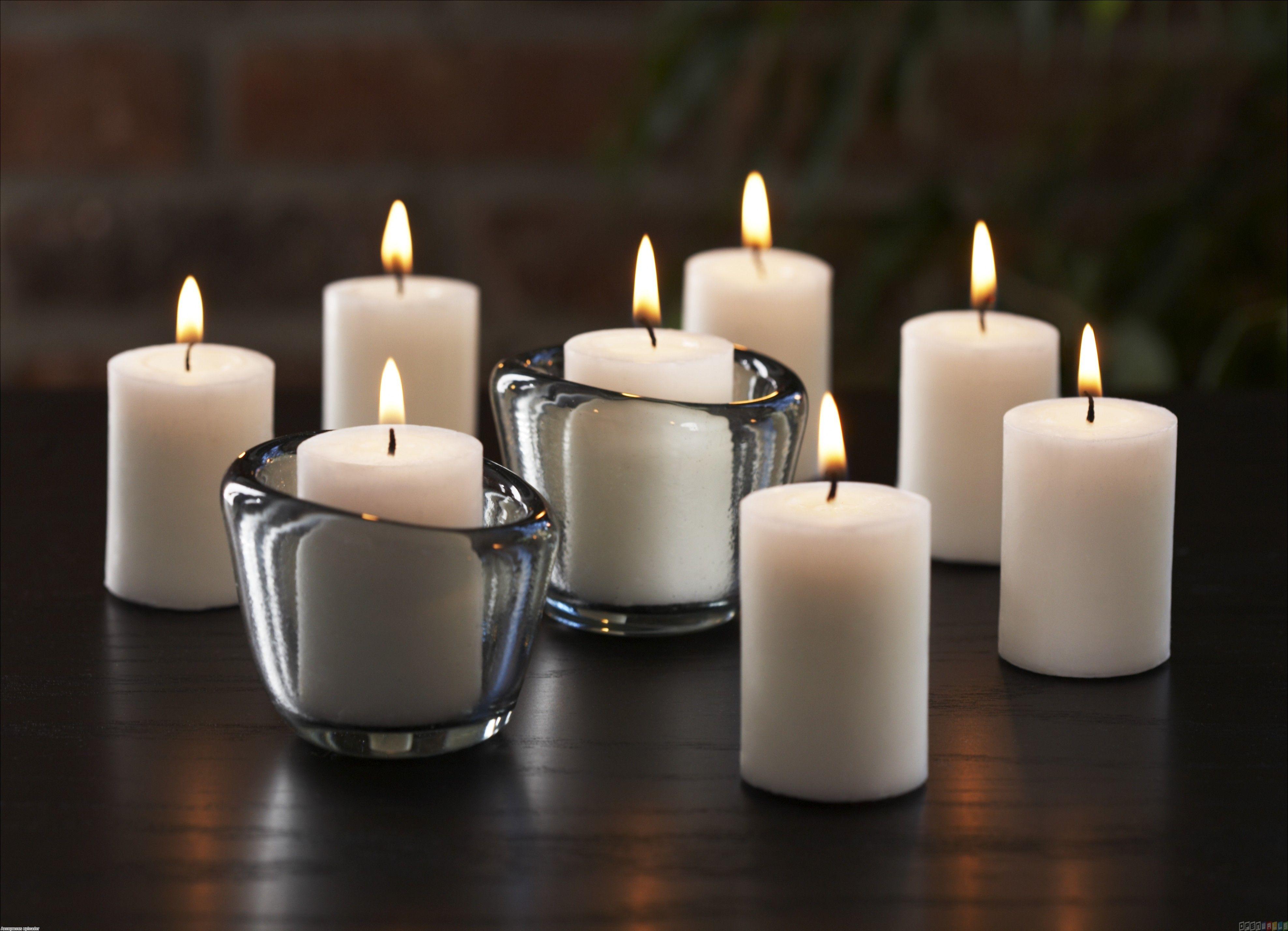 Lit white candles wallpaper Open Walls