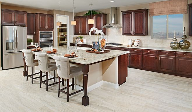This Designer Kitchen In Las Vegas, NV, Features Warm Cabinets, Contrasting Granite Countertops