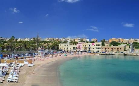 This Blue Flag sandy beach is in the heart of Paceville, Malta's party capital.