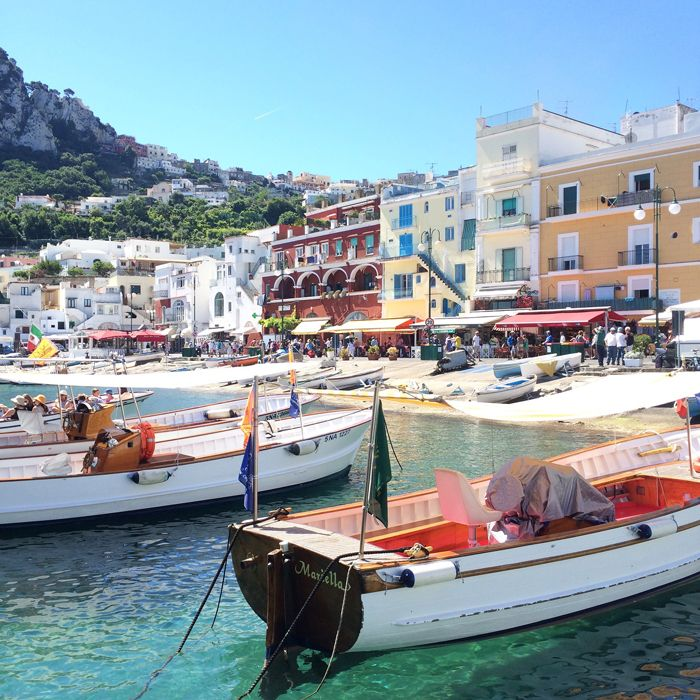 Capri Travel Guide:  Splurge on a private boat tour, visit Blue Grotto, may need to pay for transportation to the beach, stay here instead of Naples, buy fresh fruit from street vendors
