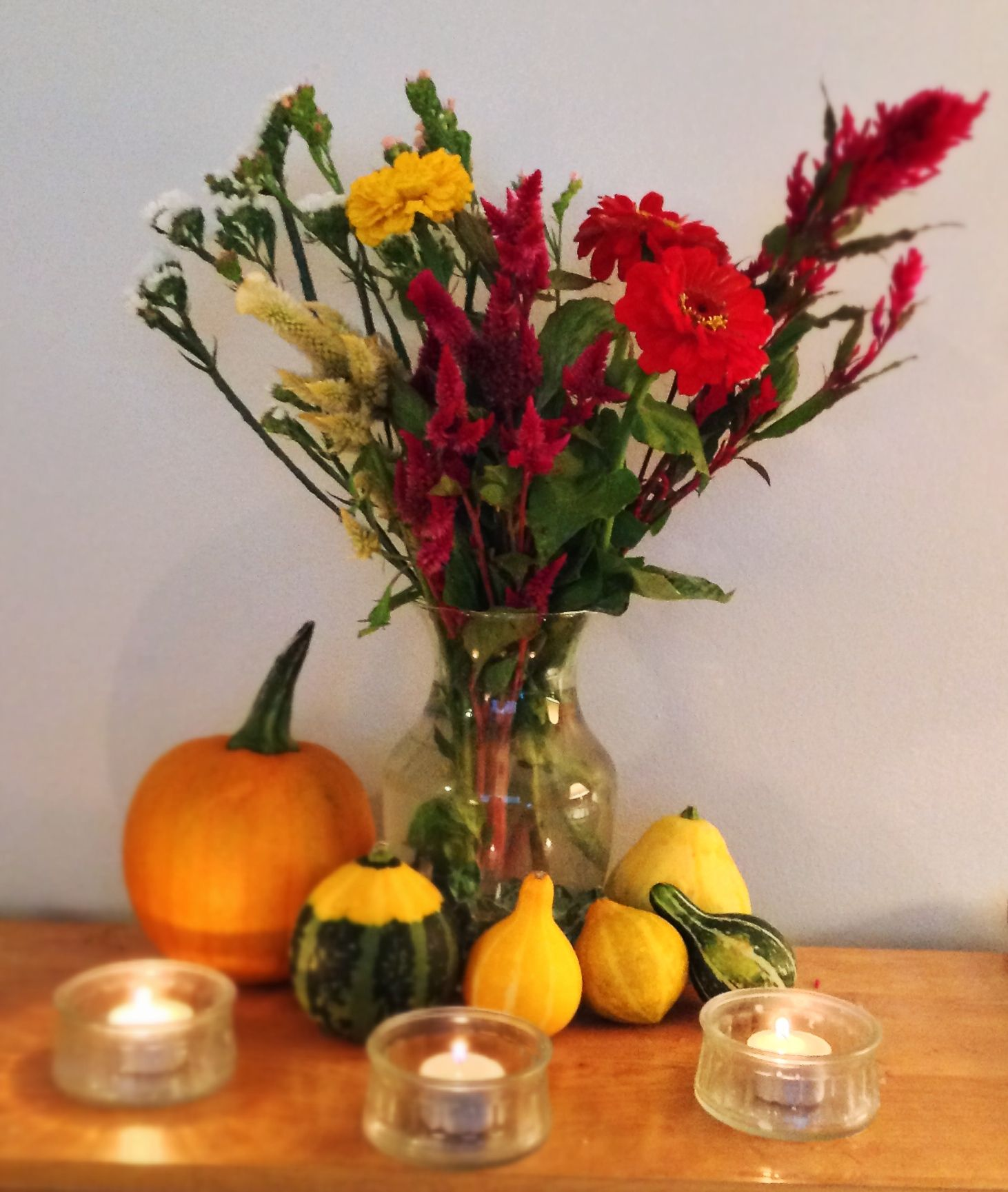 #thanksgiving #fall #mantle #decor   A few gourds and fresh flowers are all you need to make your mantle piece shout FALL! Put 1/2 a tablespoon of bleach in the vase to help preserve the flowers!