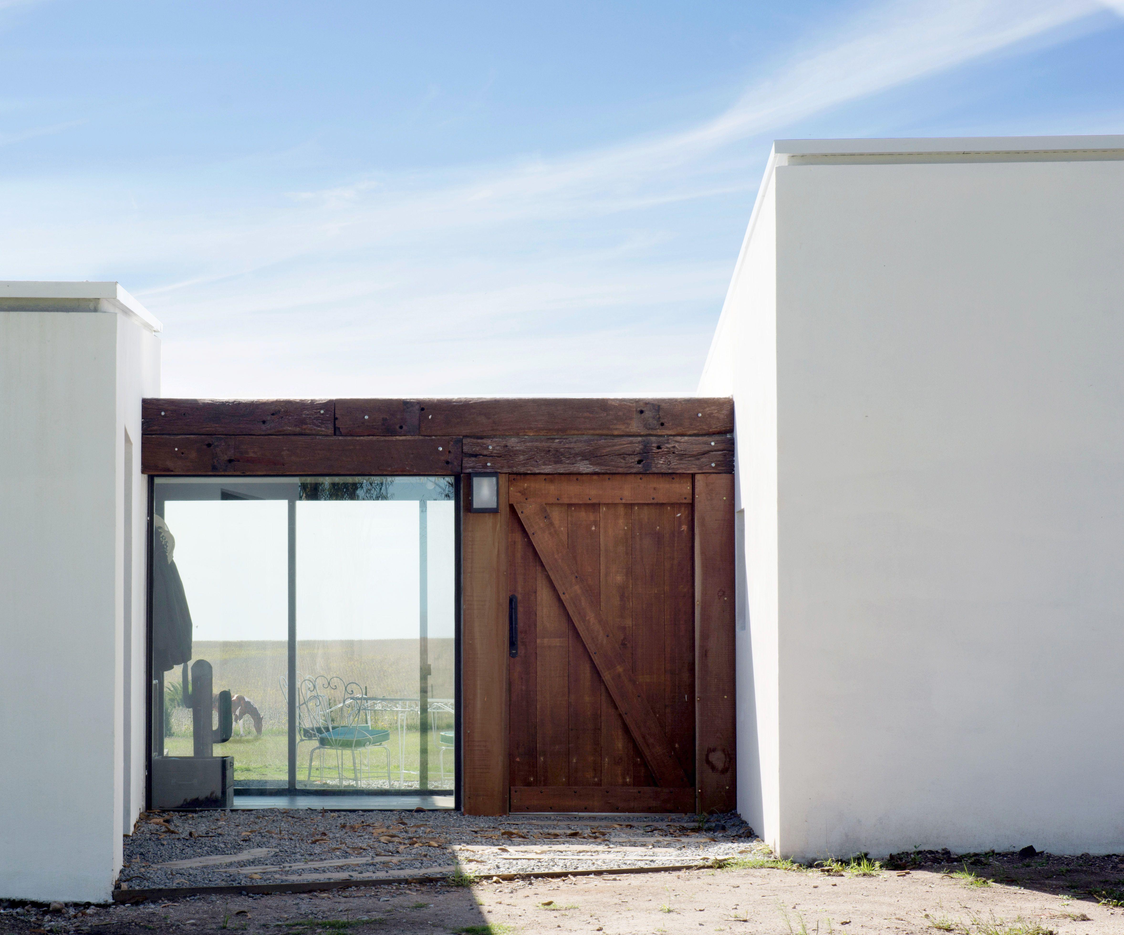 Casa de campo Los cardenales por Facundo Ochoa Arquitectura moderna