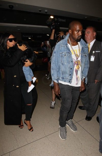 9a95ecb973ec4 Kanye West Seen on LAX Airport wearing fear of god denim jacket and a  vintage chanel