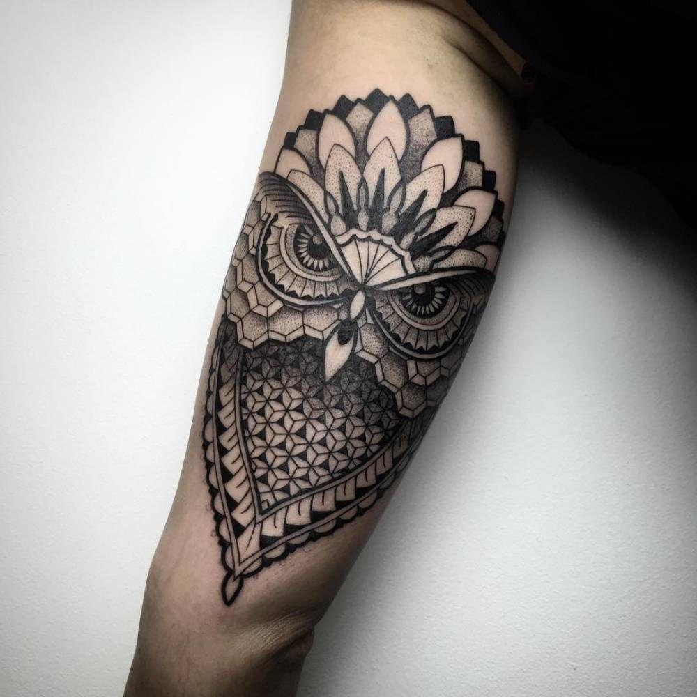 geometricblackwork style owl tattoo on the left inner arm