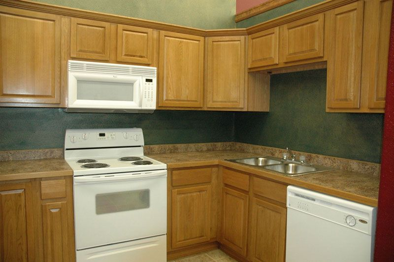 Boring Safe Dated You Can Do Better Honey Oak Cabinets Unfinished Kitchen Cabinets Kitchen Interior
