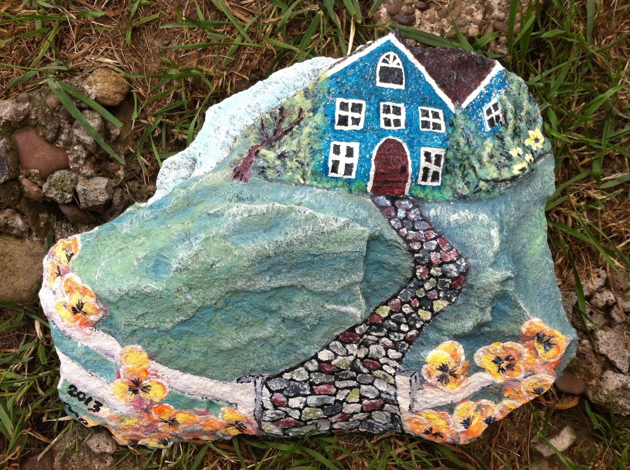 "Painted this today 5/30/13, used the ""House on a hill"" painted rock I have pinned for inspiration. Think I will be doing more of this."
