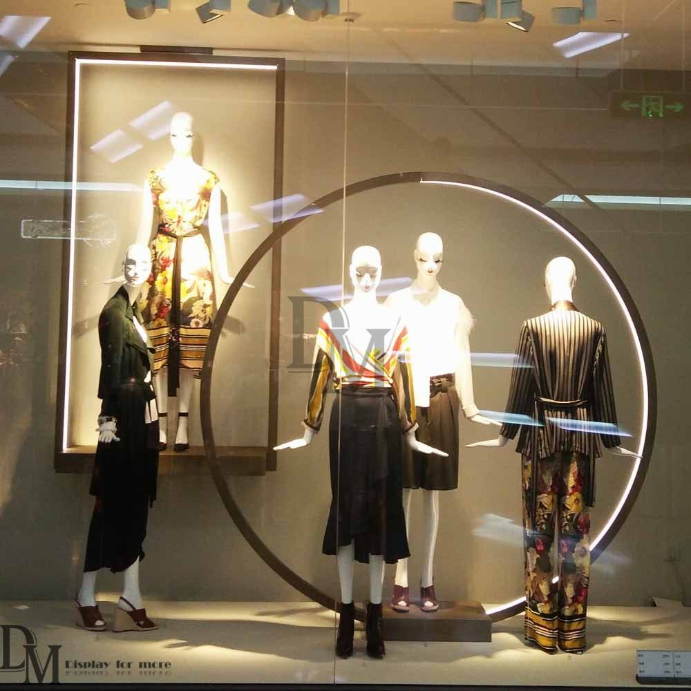 Brass large round wrought iron window display art with mannequins