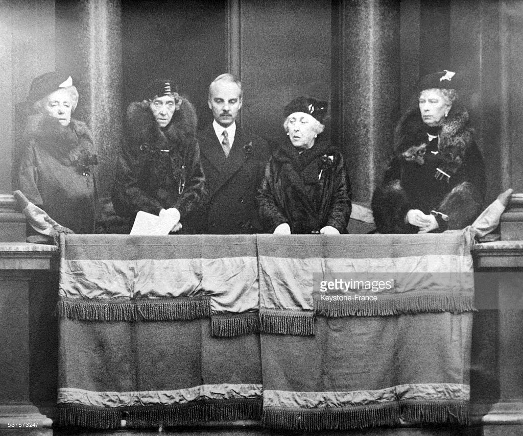 The Queen of England, Mary of Teck, surrounded by other personalities, is in the lodge of the White Hall during the ceremony in front of the Cenotaph on November 11, 1933 in London, United Kingdom.