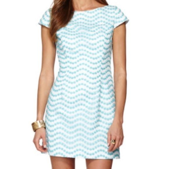 Lilly Pulitzer Piper Shift Dress New with Tags.  Size 4.  White dress with blue daisy /overlay embroidery.  Keyhole cutout in back.  Cap sleeve. Lilly Pulitzer Dresses