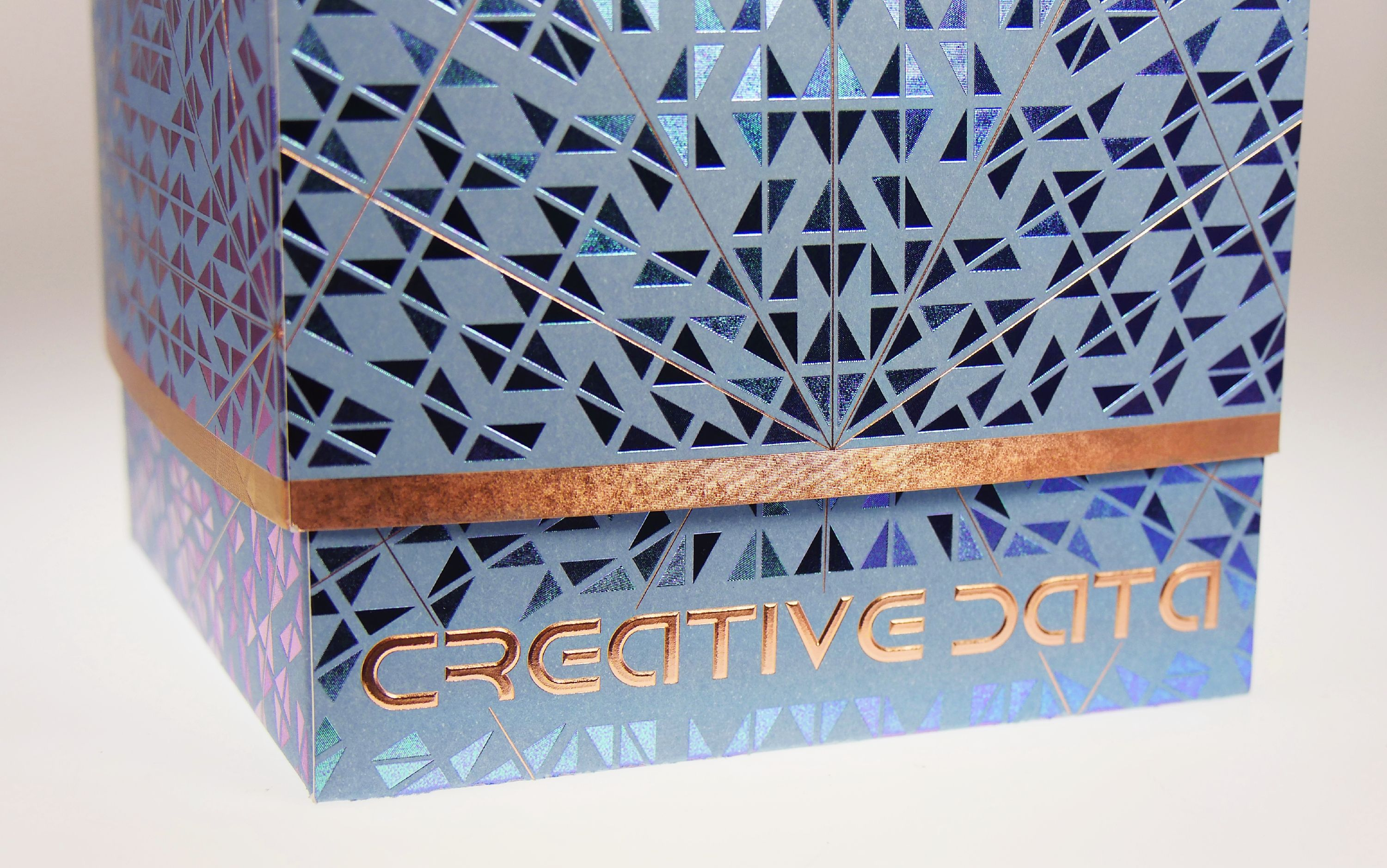 Copper foils, embossing and brilliant blue create stunning packaging. www.kurzusa.com