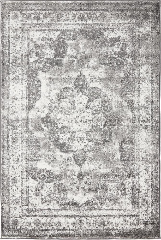 """This Turkish Monaco rug is made of Polypropylene. This rug is easy-to-clean, stain resistant, and does not shed.  Colors found in this rug include: Gray, Beige. The primary color is Gray.  This rug is 1/3"""" thick."""