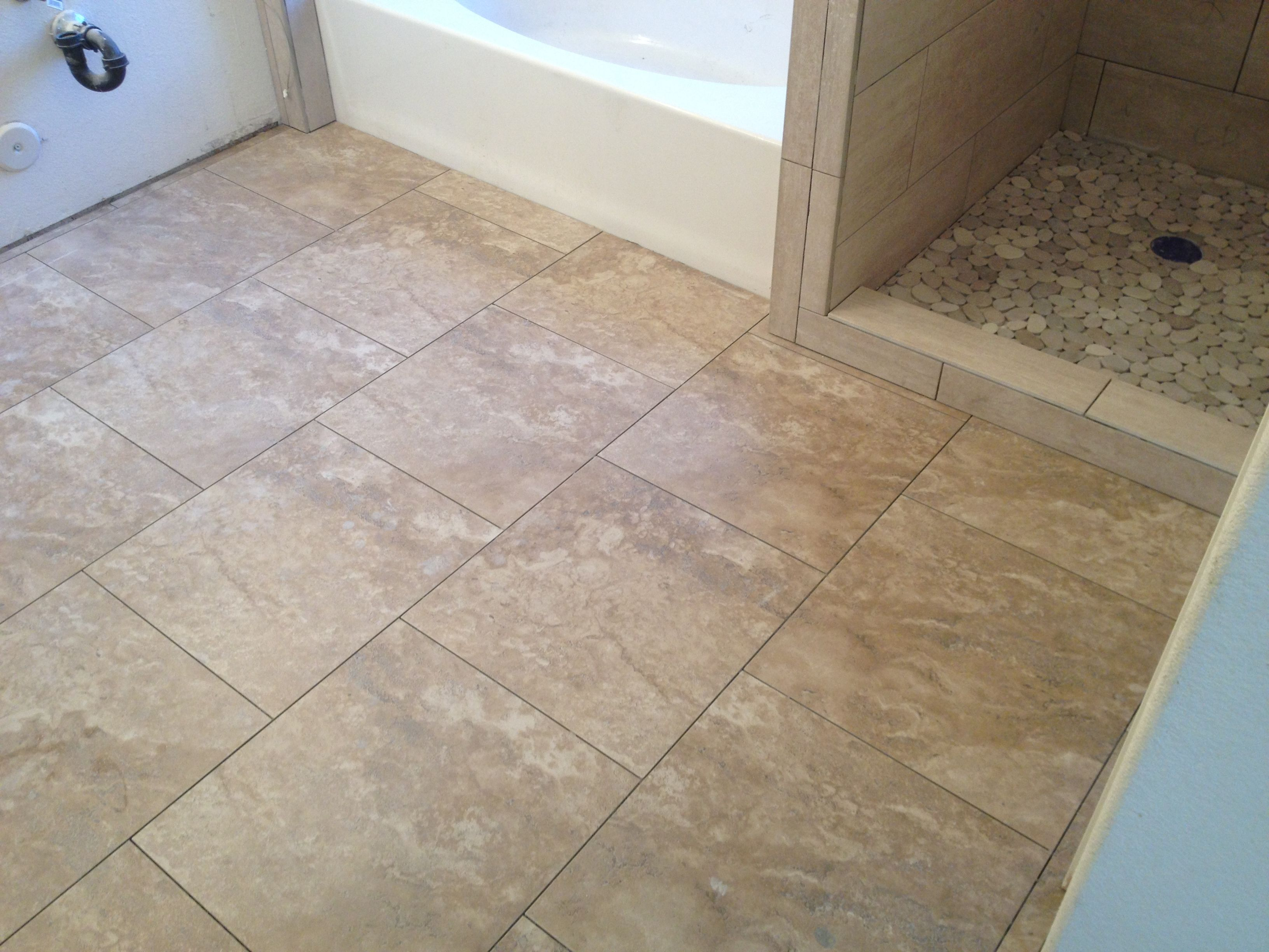 20x20 tile laid on diagonal in small bathroom.