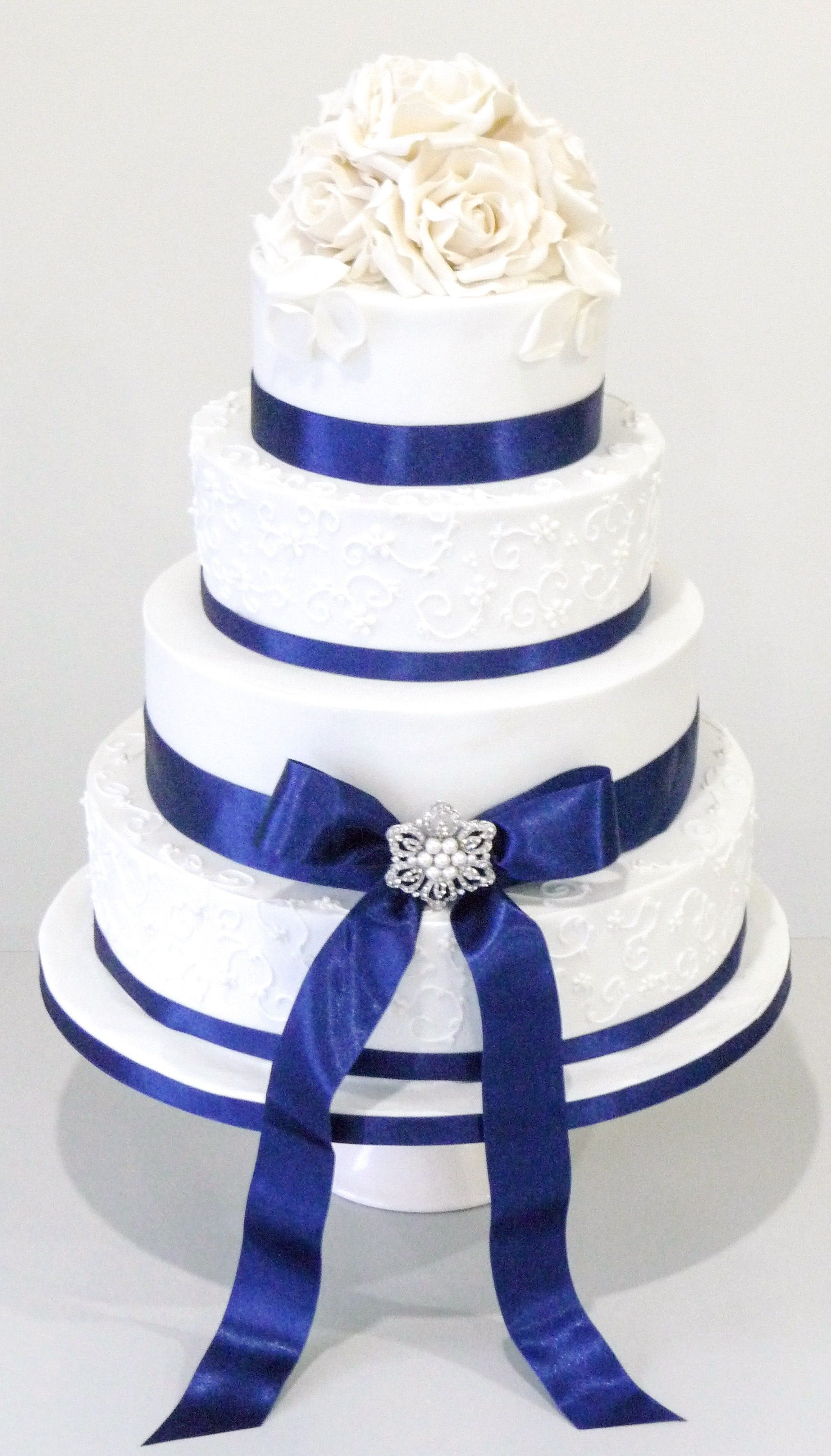 white sugar flowers on this 4 tier wedding cake with royal blue ribbon detail https www. Black Bedroom Furniture Sets. Home Design Ideas