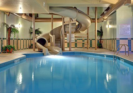 Mansion with indoor pool with diving board  Poolhouse With Slides: imagine a 2 story pool house with water ...