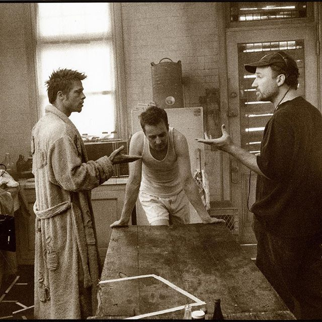 """Brad Pitt, Edward Norton, and director David Fincher on the set of the Oscar-nominated """"Fight Club"""" (1999). If you were to screen a double feature of Fincher films, which two would you pick?"""
