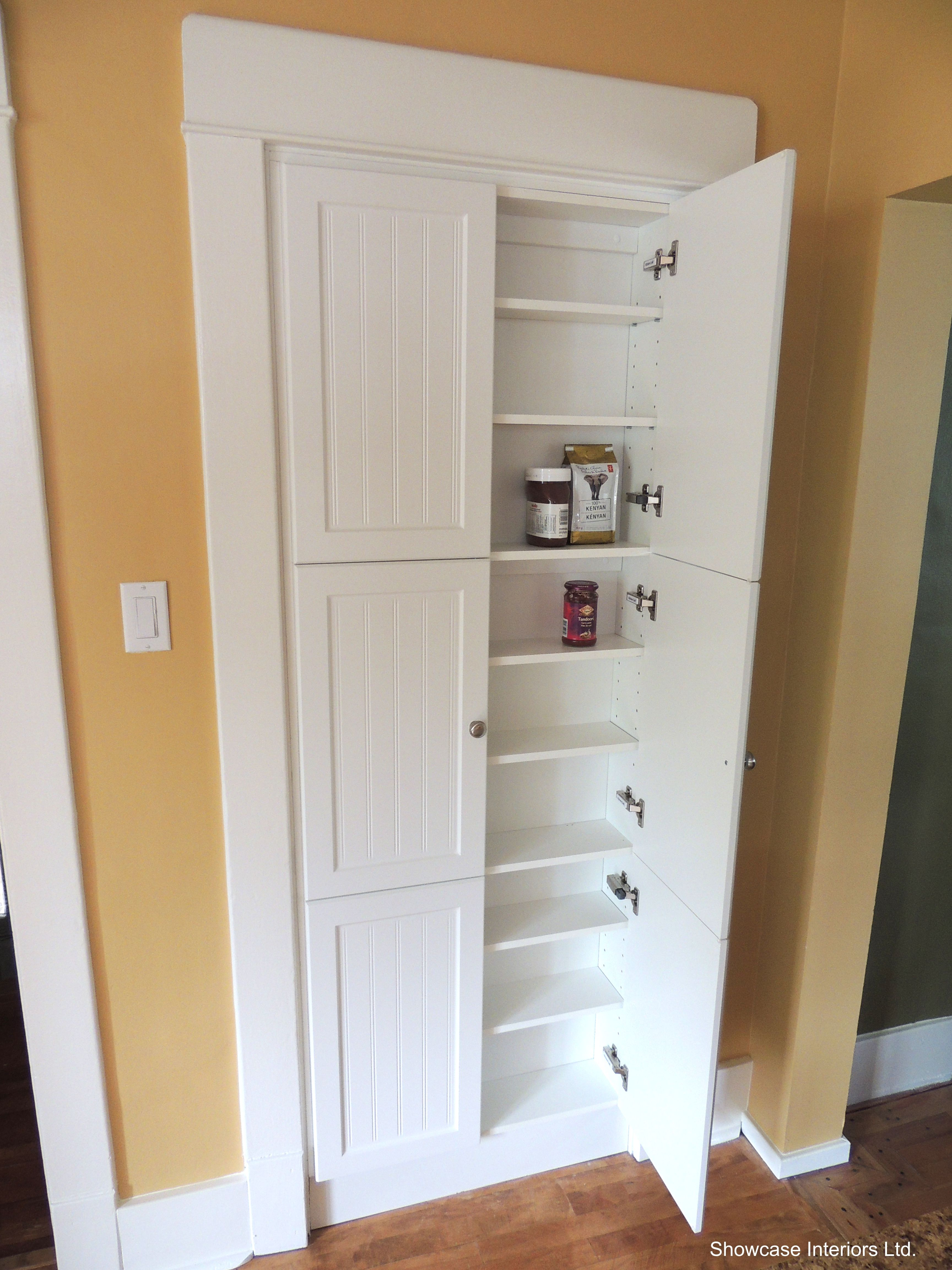 A shallow pantry cabinet in place of the pre existing for Kitchen closet cabinets