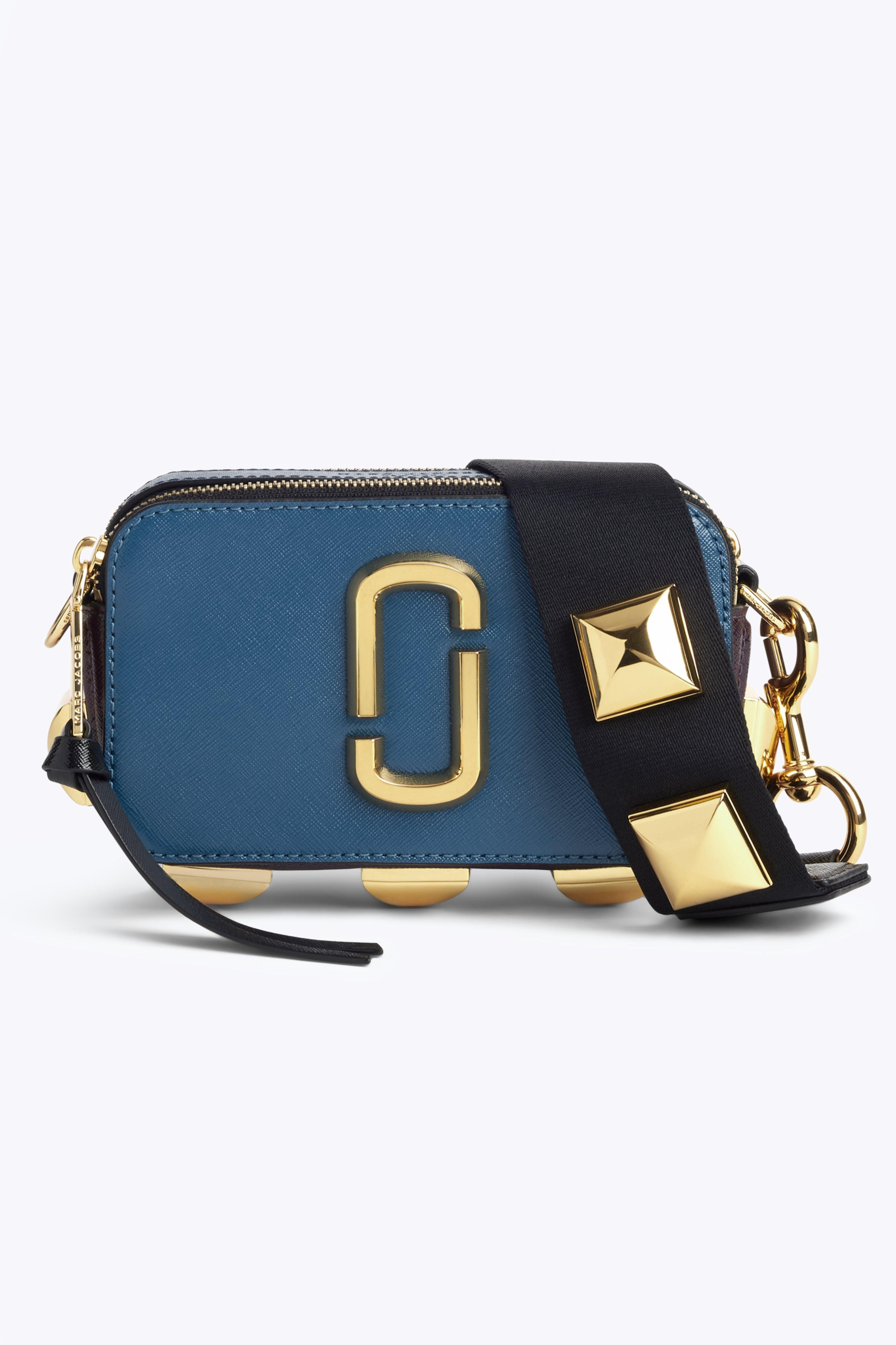 47e7be28db1d Need a compact carryall  Shop Marc Jacobs  best-selling Snapshot ...