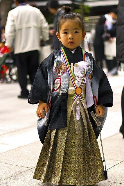 cute asian little girl in folklore dress, japan?