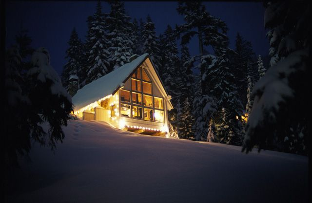 Cabin On Top Of Hill In Snow Covered Landscape At Night, Crystal Mountain,  Washington