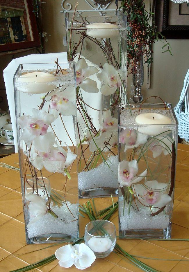 A faire avec du sable ds le fond et des fleurs de tiare, hibiscus ou autre et quelques coquillages