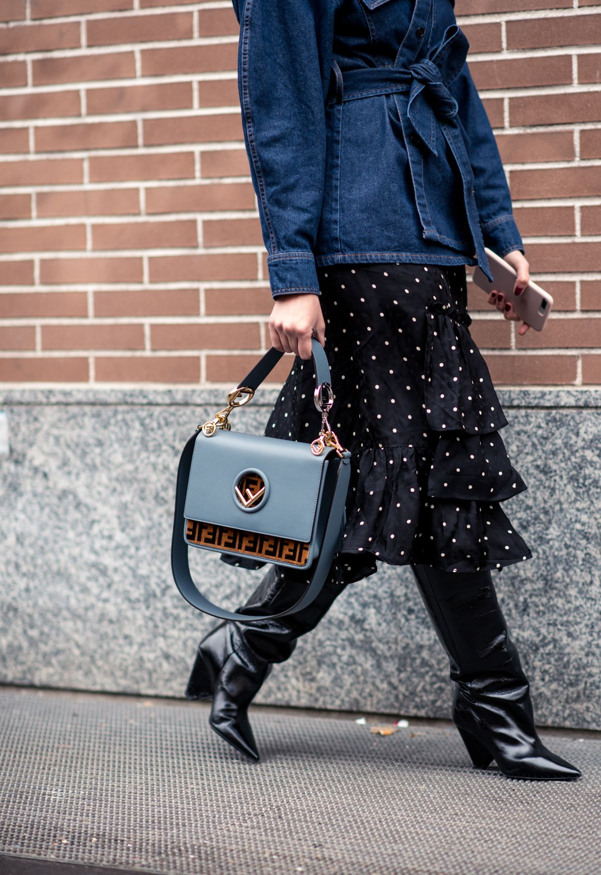 e0e98b3dc5 Spotted at  MFW – the Fendi Kan I logo-print handbag. The FF logo motif and  elegant blue-grey shade score serious  style points.