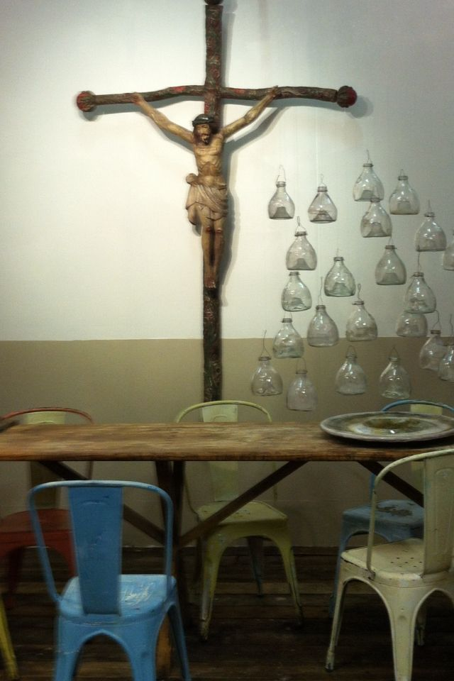 Table. Chairs. Crucifix. Flycatchers