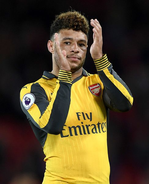 Alex Oxlade-Chamberlain of Arsenal shows appreciation to the fans after the Premier League match between Liverpool and Arsenal at Anfield on March 4, 2017 in Liverpool, England.