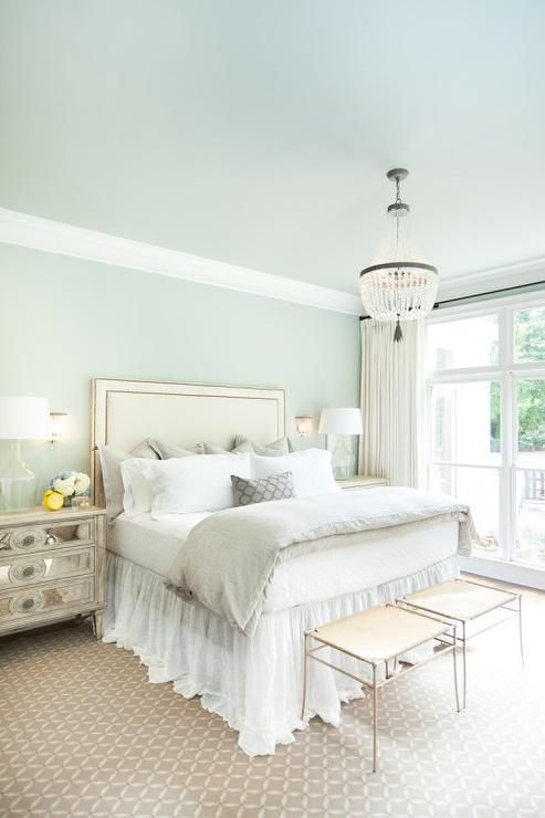 cream and blue bedroom features a blue ceiling over blue