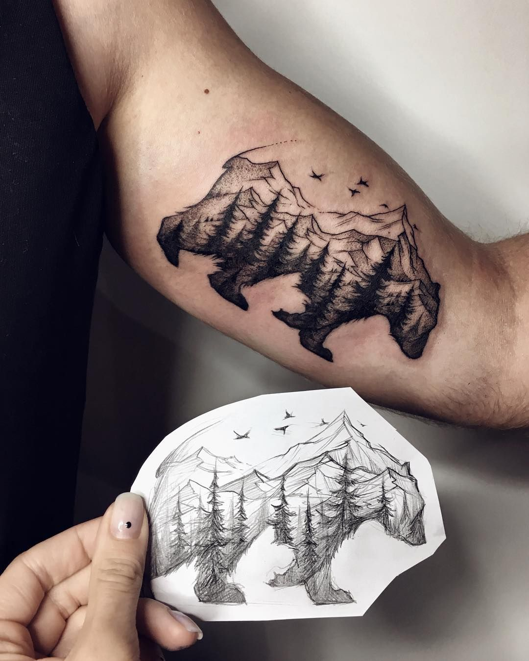 Great black bear with trees tattoo idea on the sleeve