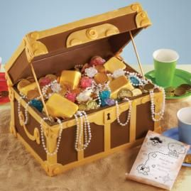Present a buccaneer's bonanza. Fill a treasure chest built from candy plaques and Sheet Pan cakes with gold candy bars shaped in our Petite Loaf Pan, chocolate coins and strands of white pearl beading.