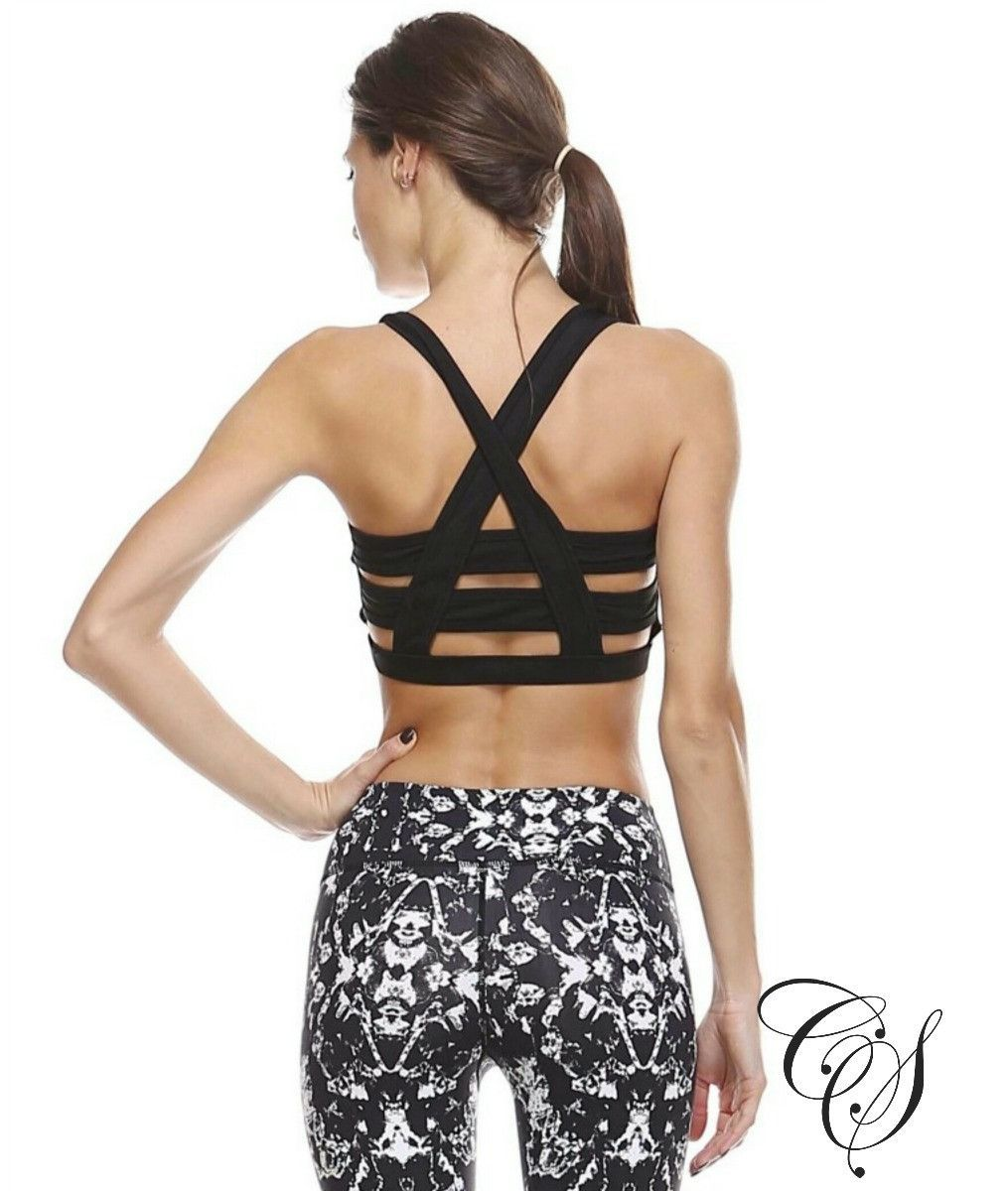 0a7cb129007 Explore Yoga Workout Clothes and more! Power through your next workout with  this strappy cross back sports bra. In a black