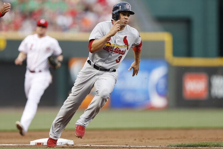 Carlos Beltran heads toward home to score a run after a single by Allen Craig (not pictured) in the second inning of the game against the Cincinnati Reds...Cards won the game 13-3.  8-02-13