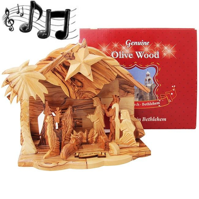 Hand made by a Christian family in the town of Yeshua' (Jesus) birth, Bethlehem. This authentic all Olive Wood Nativity features an added music box that plays 'Silent Night' when you turn the Star of Bethlehem on the Nativity rooftop. Size: 8 x 4 inches .