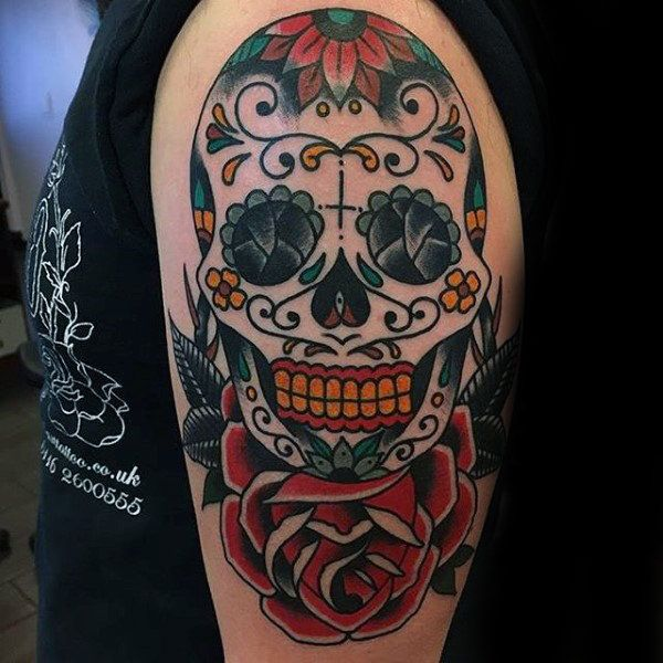 Cool Sugar Skull Tattoos For Guys On Upper Arm With Red Rose Flower Candy Skull Tattoo For Men Candy Skull Tattoo Sugar Skull Tattoos