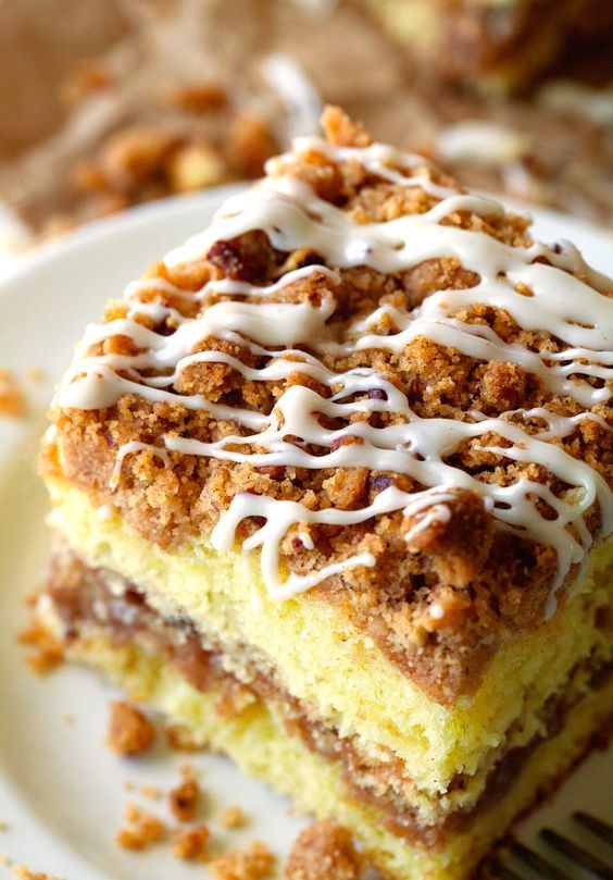 Extreme Crumb Cinnamon Roll Coffee Cake. It's all about that amazing crumb mixture found inside the cake. You can never have enough brown sugar, butter and cinnamon… especially when melted and infused into the cake.