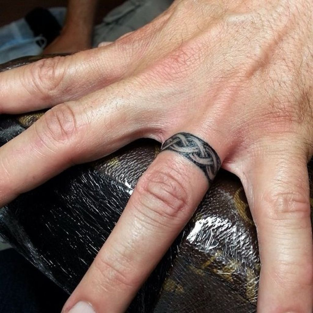 Wedding Ring Tattoo Ideas Amazing Designs For Couples Intended For Irish Wedding Ring Tattoos Iris Wedding Band Tattoo Tattoo Wedding Rings Wedding Ring Tattoo