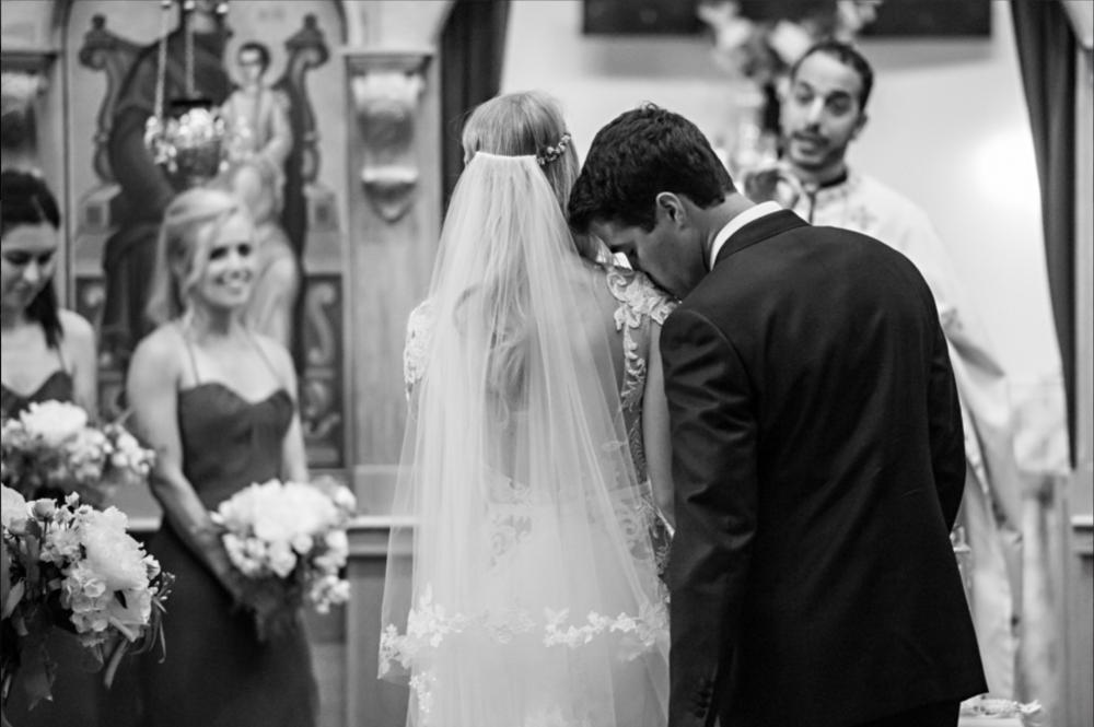 groom kisses bride on the shoulder during ceremony Wedding Ceremony Photo  | Treasury on The Plaza | St. Augustine, Florida Wedding Venue