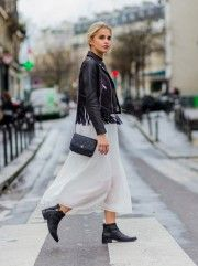 Caroline Daur has created another boho ensemble here by pairing a sheer maxi skirt with a tasselled leather jacket and matching leather pixie boots. We think this outfit is great for a more sophisticated - yet no less bohemian - style! Skirt/Jacket: Maje, Shoes: Pavement, Bag: Chanel.