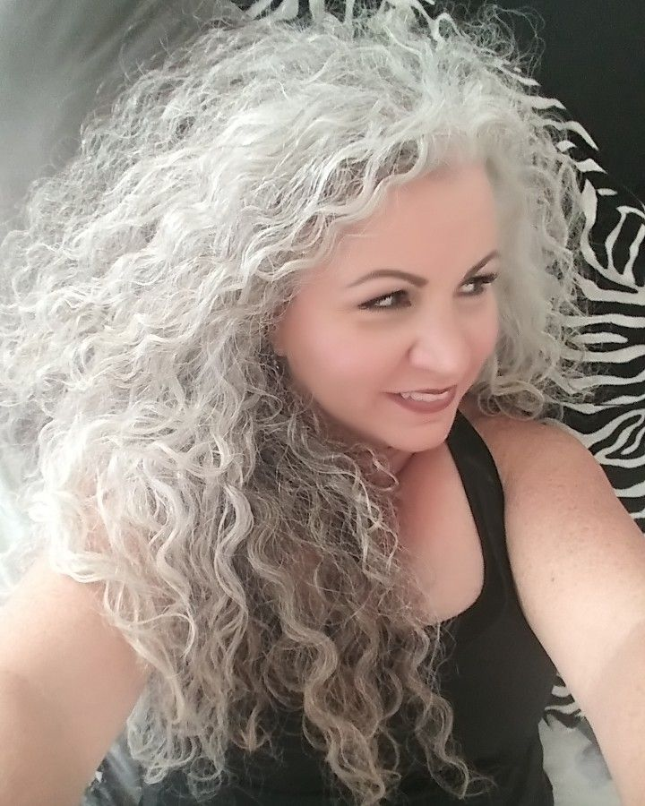 I Love That I Let My Hair Go Natural The Curl And The Grey Are All Me Long Grey Curly Hair Curly Hair Styles Long Gray Hair Grey Curly Hair