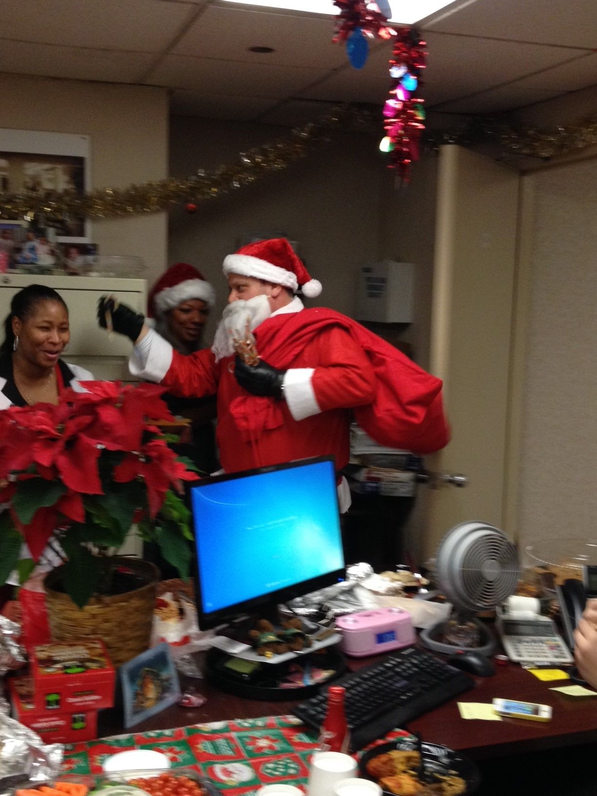 Santa Giving Out Gifts In The Sales Office Holidays In New York Holiday Decor Holiday